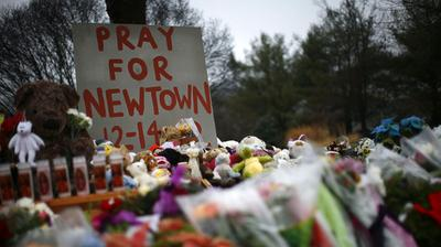 Flowers, candles and stuffed animals make up a makeshift memorial in Newtown, Conn., days after the 2012 shooting. (Reuters/Landov)