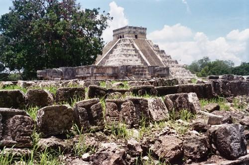 A frieze of skulls adorns the side of the Tzompantli, the platform probably used to exhibit sacrificed prisoners at the ancient Maya city of Chichen Itza, with the main pyramid, El Castillo, in the background, in Mexico. (AP)