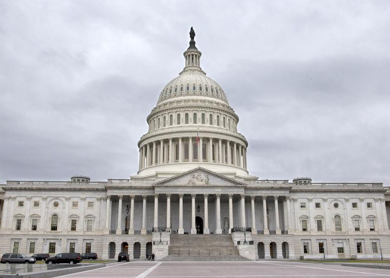 Gray clouds fill the sky over the Capitol in Washington, Tuesday, Jan. 1, 2013. (Jacquelyn Martin/AP)