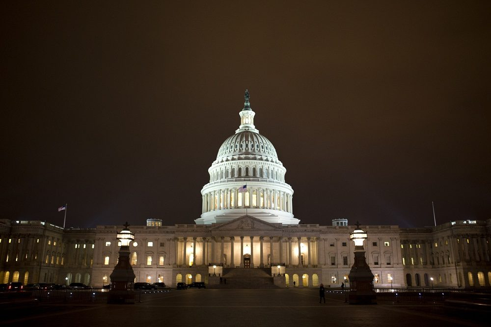 """The lights of the U.S. Capitol remain lit into the night as the House continues to work on the """"fiscal cliff"""" on Tuesday, Jan. 1, 2013. (AP/Jacquelyn Martin)"""