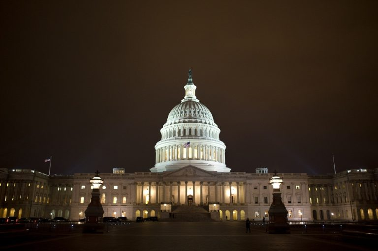 "The lights of the U.S. Capitol remain lit into the night as the House continues to work on the ""fiscal cliff"" on Tuesday, Jan. 1, 2013. (AP/Jacquelyn Martin)"