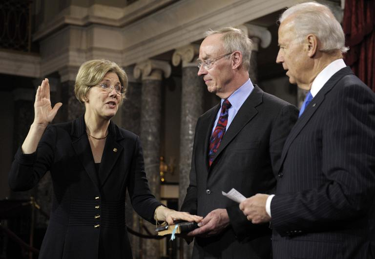Vice President Joe Biden administers the oath of office to Sen. Elizabeth Warren, who's accompanied by her husband, Bruce Mann, during a mock swearing in ceremony on Capitol Hill Thursday. (Cliff Owen/AP)
