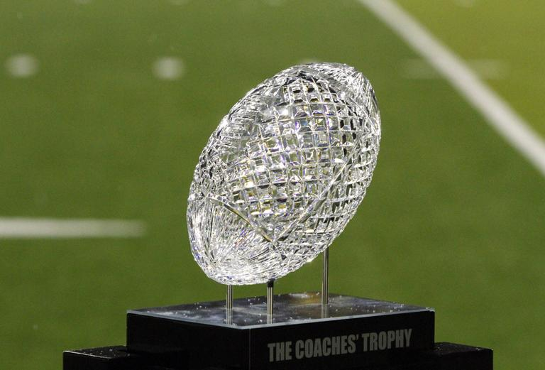 The Coaches' Trophy is awarded to the winner of the BCS National Championship game. It's hard to figure out how many titles Notre Dame and Alabama already have. (Don Ryan/AP)