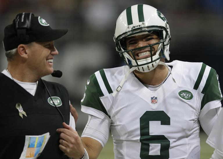 New York Jets coach Rex Ryan (left) reportedly has a new tattoo featuring a woman wearing quarterback Mark Sanchez's jersey. (Tom Gannam/AP)