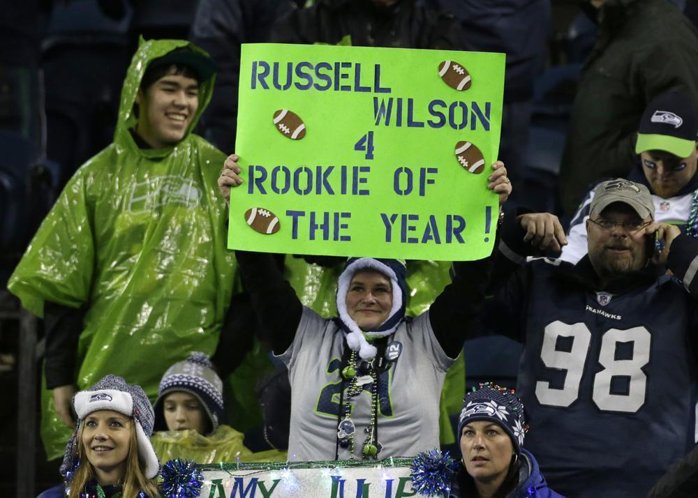 Fans in Seattle are hopeful about the Seahawks' postseason prospects behind quarterback Russell Wilson. (Elaine Thompson/AP)