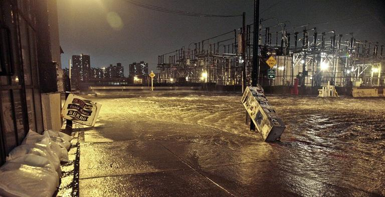This Oct. 29, 2012 photo shows flooding in the streets around a Con Edison substation as the East River overflows into the Dumbo section of Brooklyn in New York during Superstorm Sandy.(AP /Bebeto Matthews)