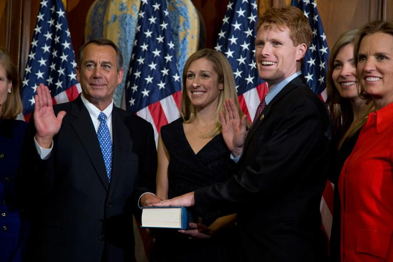 House Speaker John Boehner performs a mock swearing in for new Rep. Joseph Kennedy Thursday on Capitol Hill. (Evan Vucci/AP)