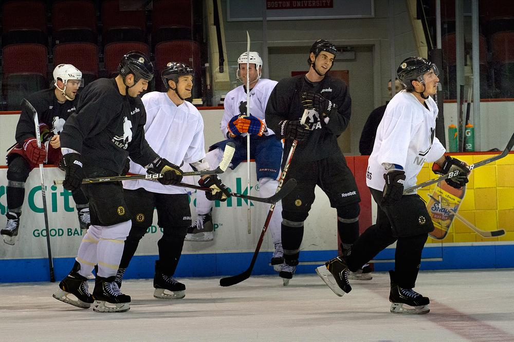 Bruins including, Milan Lucic (second from left), Andrew Ference, Adam McQuaid (second from right) and Brad Marchand take part in an unofficial practice at Boston University Monday. (Jesse Costa/WBUR)