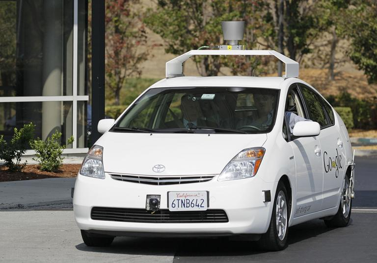 California Gov. Edmund G Brown Jr., front left, rides in a driverless car to a bill signing at Google headquarters in Mountain View, Calif., in September 2012. (Eric Risberg/AP)
