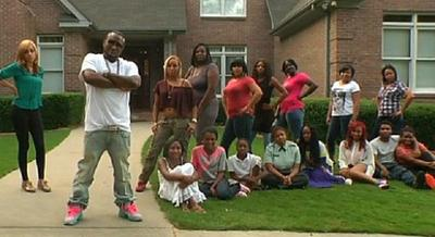 "Rapper Shawty Lo is pictured with his 11 children and their 10 mothers in an online video promoting the planned Oxygen TV special ""All My Babies' Mamas."" (screenshot)"