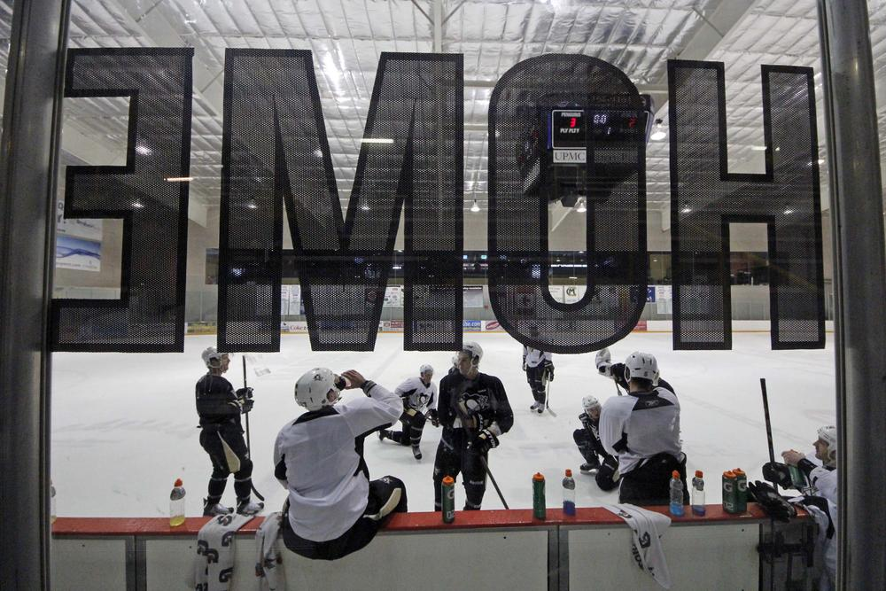 Players from the Pittsburgh Penguins held an informal practice Monday after the NHL and the players' association announced a tentative agreement to end the lockout. (Gene Puskar/AP)