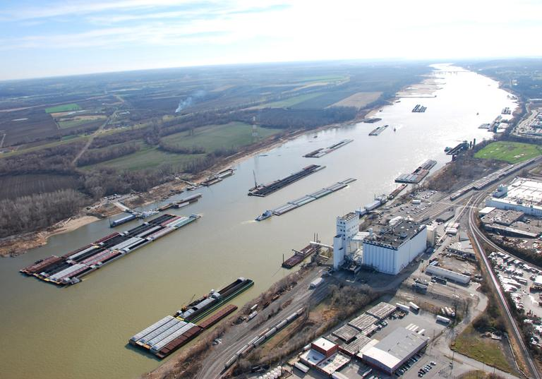 Barges passing in tight quarters due to low water levels as they navigate the Mississippi River near St. Louis in December 2012. (Colby Buchanan/United States Coast Guard/AP)
