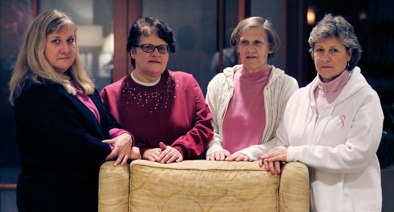 The Melnick sisters, who allege that a synthetic estrogen known as DES caused them all to get breast cancer, pose at a Boston hotel on Monday. From left are Francine Melnick, Andrea Andrews, Donna McNeely and Michele Fecho. (Charles Krupa/AP)