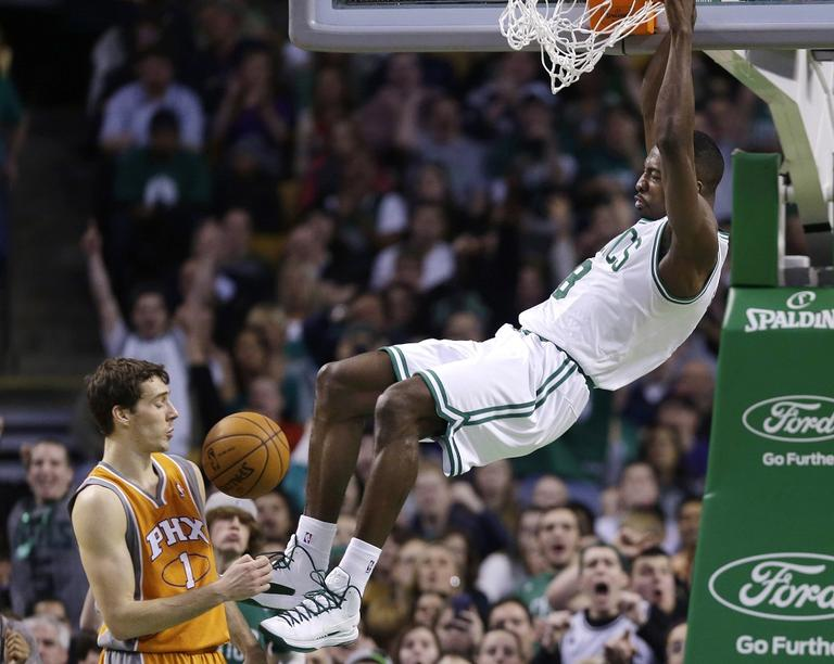 Celtics power forward Jeff Green dunks against Phoenix Suns point guard Goran Dragic on Wednesday. (Elise Amendola/AP)
