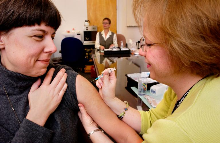 In the United States, the flu season can range from November through March, and even past March in some years. Here, a CDC employee receives a flu vaccine from CDC Staff Nurse. (James Gathany/CDC)