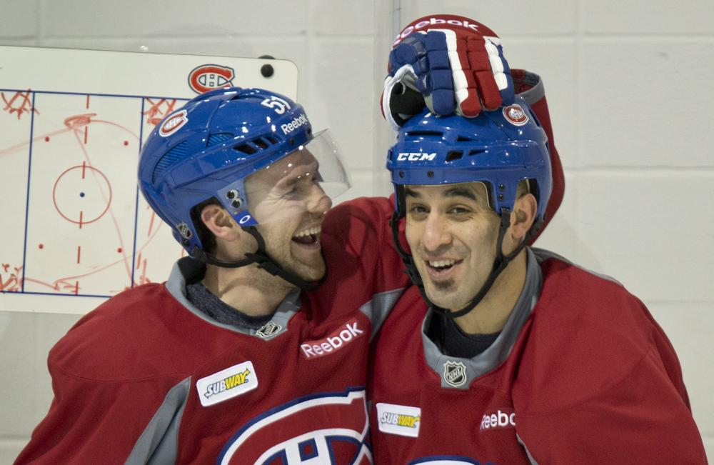 Montreal Canadiens David Desharnais (l) and Scott Gomez aren't the only ones smiling these days. NHL fans will soon see their teams on the ice now that the lockout is ending. (Paul Chiasson, The Canadian Press/AP)