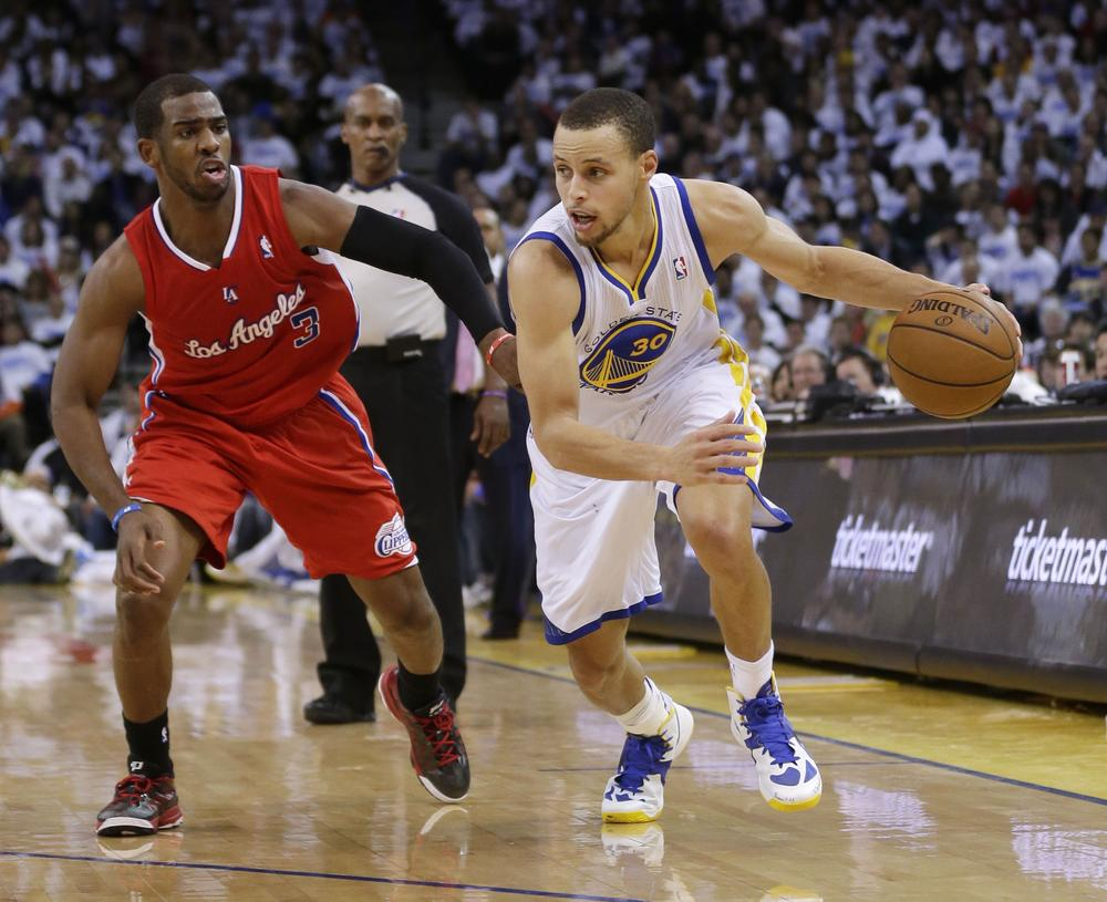 Warriors Assistant General Manager Kirk Lacob is helping the team use 'Moneyball'-style analytics to maximize the talents of players like guard Stephen Curry (right). (AP)