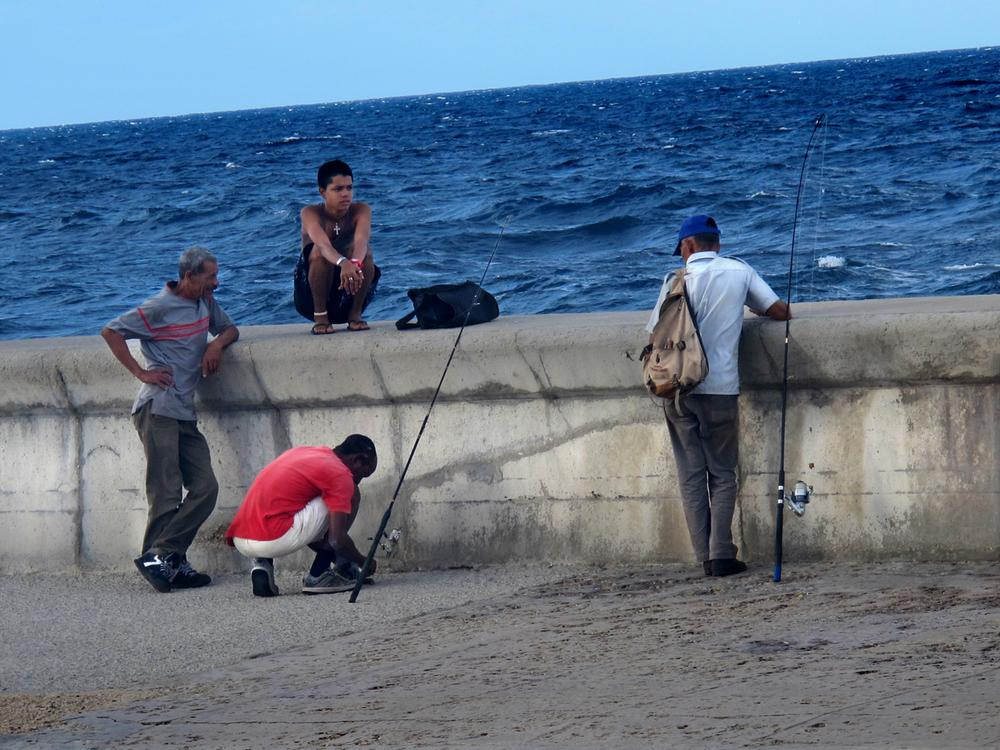 Fishermen, young and old, along the Malecon, Cuba's famous waterfront roadway.
