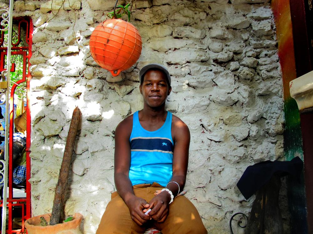 A young Cuban man graciously sits for a photo in the Callejon de Humel, a popular public art project in Havana.
