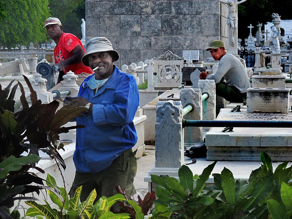 Workers employed by the Cuban government keep the tombstones in the historic Colon Cemetery pristine.