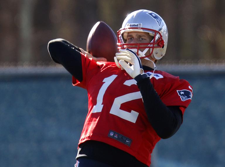 Quarterback Tom Brady throws a pass during practice at the team's facility in Foxborough on Thursday. The Pats host the Houston Texans in an AFC divisional playoff game on Sunday. (Stephan Savoia/AP)