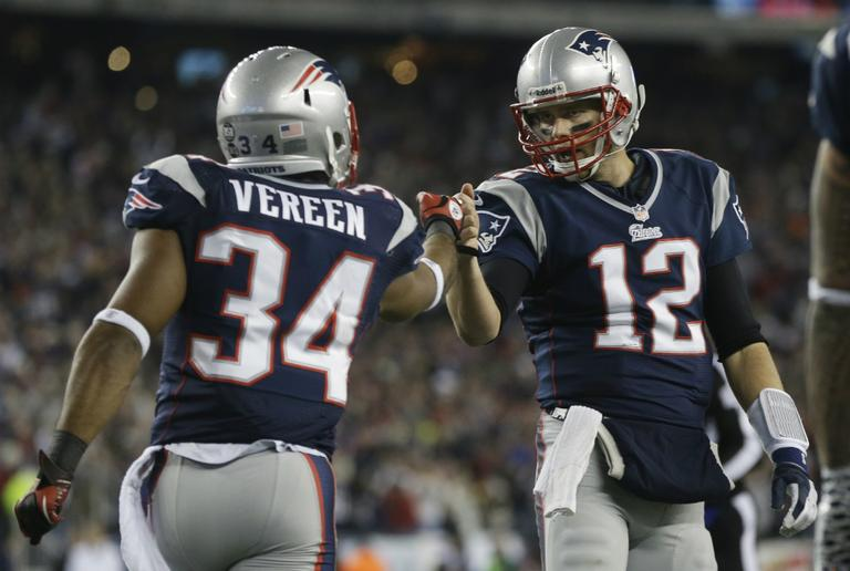 New England Patriots running back Shane Vereen, left, is congratulated by quarterback Tom Brady after Vareen's eight-yard touchdown pass reception from Brady during the first half of an AFC divisional playoff NFL football game in Foxborough, Mass., Sunday, Jan. 13, 2013. (Elise Amendola/AP)
