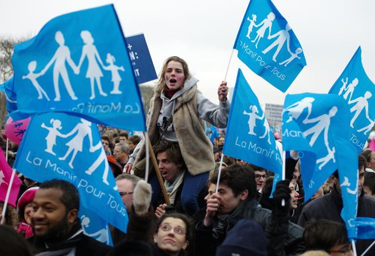 Protestors wave flags during a demonstration in Paris, Sunday, Jan. 13, 2013. Hundreds of thousands of protesters are mobilizing against the French president's plan to legalize gay marriage. (Thibault Camus/AP)