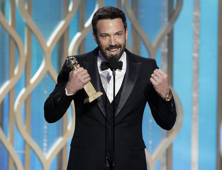"Ben Affleck with his award for best director for ""Argo"" during the 70th Annual Golden Globe Awards, Sunday in Beverly Hills, Calif. (Paul Drinkwater/NBC/AP)"