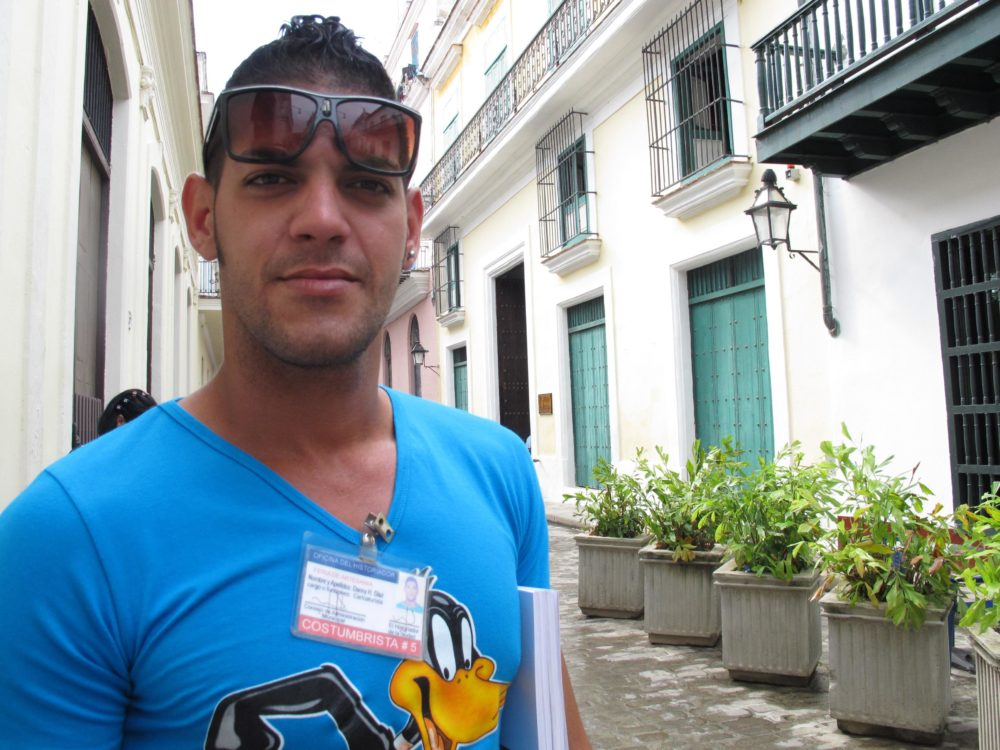 Street artist Danny Diaz has a license from the Cuban government that allows him to sell drawings to tourists. (Andrea Shea/WBUR)