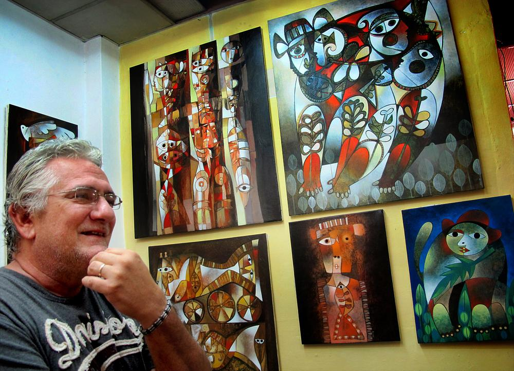 Painter Orestes Gaulhiac in his home studio. (Andrea Shea/WBUR)
