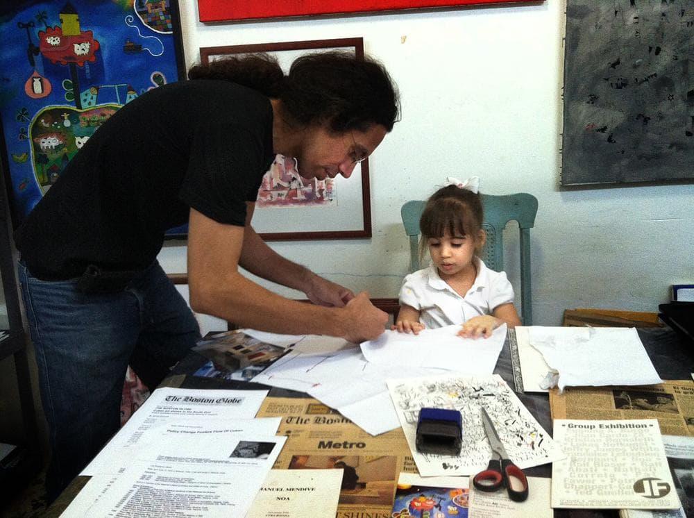 Luis Rodriguez with his daughter, Cecilia. (Andrea Shea/WBUR)