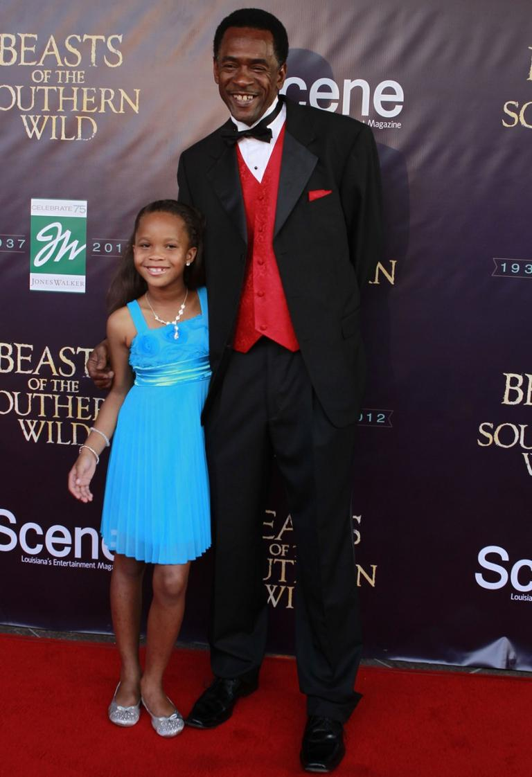 "Actress Quvenzhané Wallis and actor Dwight Henry pose for photos on the red carpet at the premiere of ""Beasts of the Southern Wild"" in New Orleans. (Gerald Herbert/AP)"