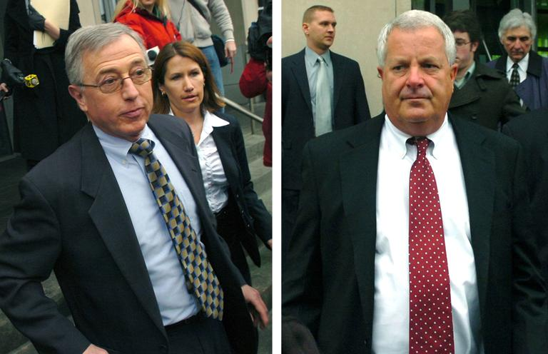 Former Luzerne County judges Mark Ciavarella (left) and Michael Conahan (right) were convicted in 2011 of taking millions of dollars in kickbacks to send youth offenders to for-profit detention facilities. They are pictured leaving the federal courthouse in Scranton, Pa. in February 2009. (David Kidwell/AP)