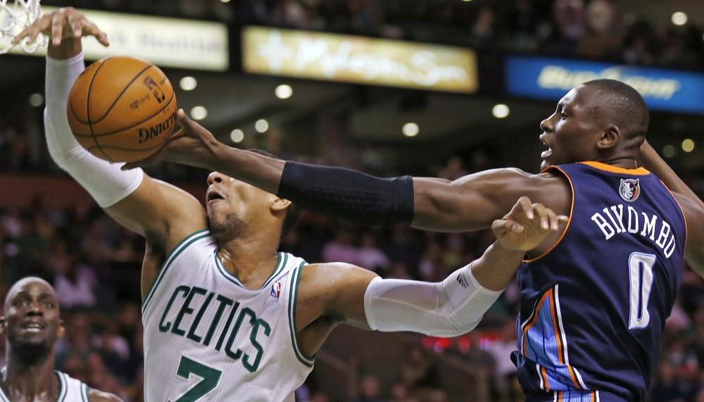 Bobcats forward Bismack Biyombo tries to grab a rebound against Celtics forward Jared Sullinger during the second half of Monday night's game in Boston. (Charles Krupa/AP)