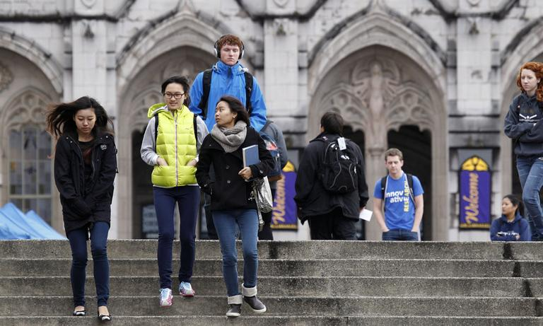 University of Washington students walk on the campus between classes in October 2012, in Seattle. (Elaine Thompson/AP)