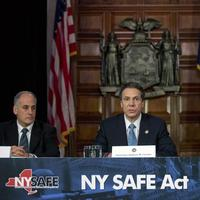 New York Gov. Andrew Cuomo, center, speaks on Monday during a news conference announcing an agreement with legislative leaders on New York's Secure Ammunition and Firearms Enforcement Act. Also pictured are Secretary to the Governor Larry Schwartz, left, and Lt. Gov. Robert Duffy. (Mike Groll/AP)
