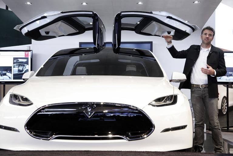 Franz von Holzhausen, Chief Designer, Tesla Motors, talks about the doors on the Tesla Model X on Tuesday in Detroit. (AP Photo/Paul Sancya)