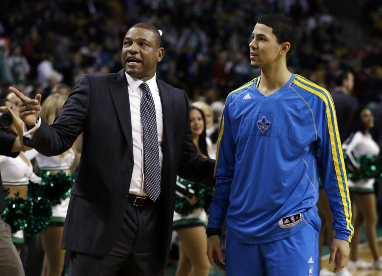 Boston Celtics head coach Doc Rivers talks with his son, New Orleans Hornets shooting guard Austin Rivers, prior to a game in Boston Wednesday. (Elise Amendola/AP)