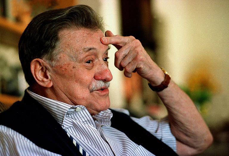 A collection of poems by the late Uruguayan novelist Mario Benedetti, pictured here in 2005, is among the recently translated works recommended by Jim Kates. (Marcelo Casacuberta/AP)