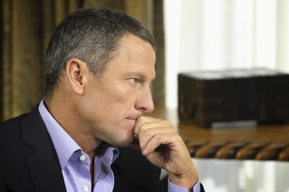 Lance Armstrong listens during his interview with talk show host Oprah Winfrey. (AP/Courtesy of Harpo Studios, Inc)