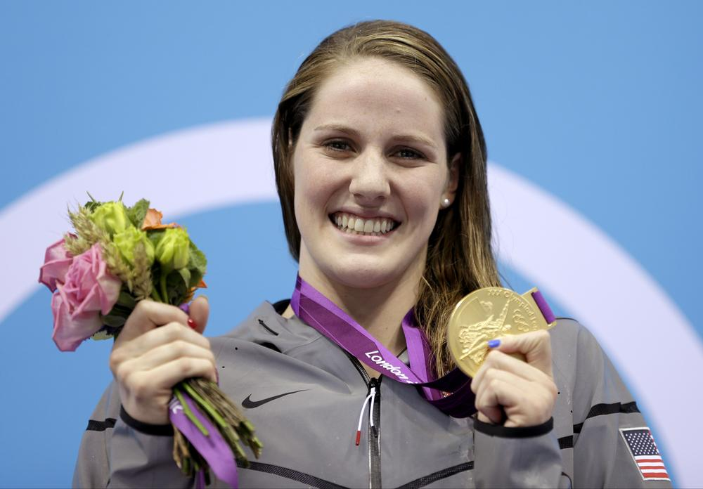 After winning four gold medals at the 2012 Olympics, 17-year-old swimmer Missy Franklin is now competing for her high school's swim team (Michael Sohn/AP)