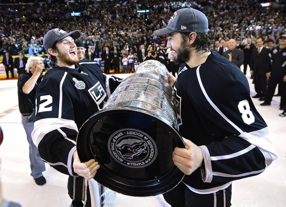 Winning one Stanley Cup was difficult enough, but repeating as NHL champs will be even harder for goalie Jonathan Quick, left, defenseman Drew Doughty, and the Los Angeles Kings (Mark Terrill/AP)