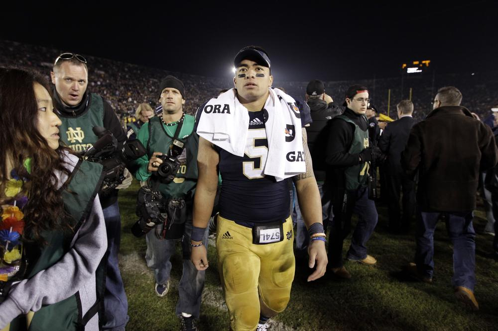 Manti Te'o survived the crush of media during Notre Dame's title run. Will he fare as well with the hecklers he's likely to encounter in the NFL? (AP/Michael Conroy)