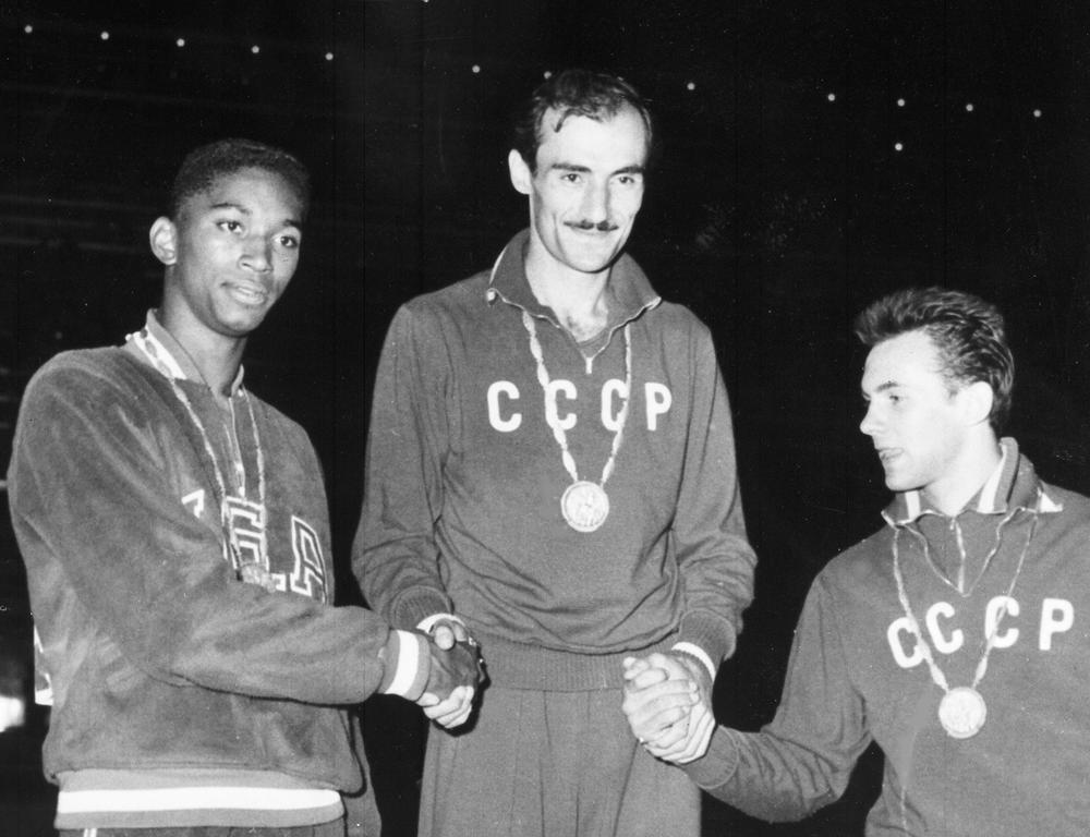 John Thomas (left) after winning the bronze at the 1960 Olympics. Thomas died on Tuesday. (AP)