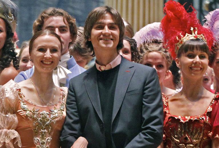 Sergei Filin, center, poses with members of the Bolshoi Theater company in September 2011. (Mikhail Metzel/AP)