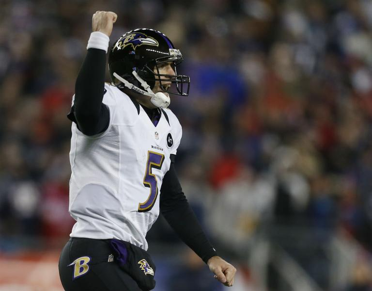 Baltimore Ravens quarterback Joe Flacco celebrates after an 11-yard touchdown pass to Anquan Boldin during the second half of the NFL football AFC Championship football game against the New England Patriots in Foxborough, Mass., Sunday, Jan. 20, 2013. (Charles Krupa/AP)