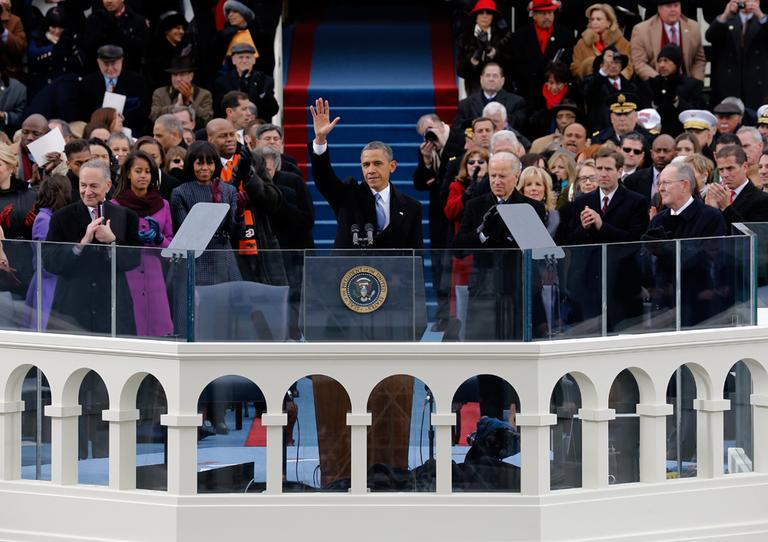 President Barack Obama waves to crowd after his Inaugural speech at the ceremonial swearing-in on the West Front of the U.S. Capitol during the 57th Presidential Inauguration in Washington, Monday, Jan. 21, 2013. (Scott Andrews, Pool/AP)