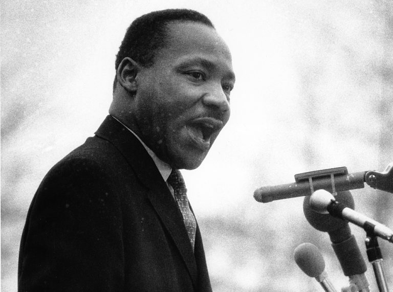 Dr. Martin Luther King Jr. speaks in front of the United Nations during a peace parade in New York on April 15, 1967. (AP)