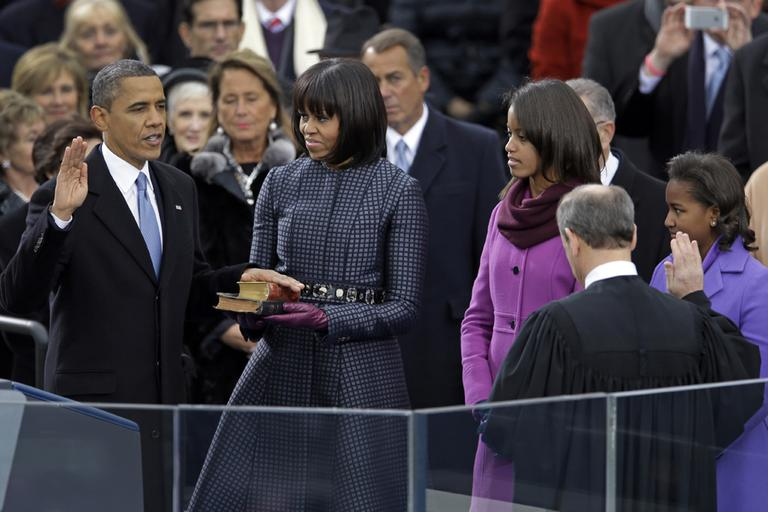 President Barack Obama receives the oath of office from Chief Justice John Roberts as first lady Michelle Obama and his daughters Malia and Sasha look on, during the 57th Presidential Inauguration in Washington. (Carolyn Kaster/AP)