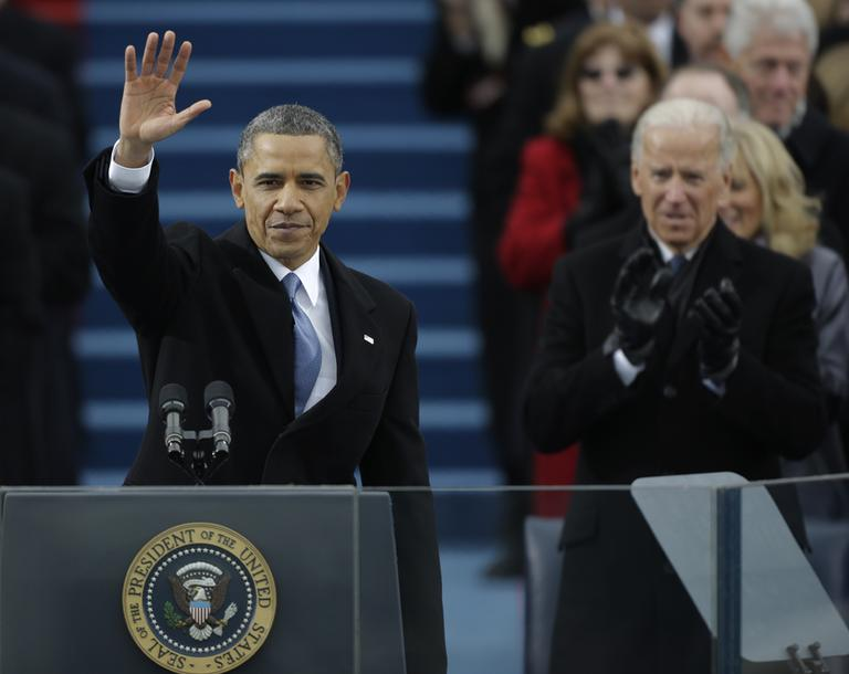 President Barack Obama waves after his speech while Vice President Joe Biden applauds at the ceremonial swearing-in at the U.S. Capitol during the 57th Presidential Inauguration in Washington, Monday. (Pablo Martinez Monsivais/AP)